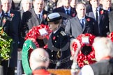 HRH The Princess Royal about to lay her wreath at the Cenotaph. In the foreground, and out of focus, the Bishop of London.