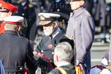 Major Fraser Smith as Equerry is handing the wreath to HRH Prince Michael of Kent.