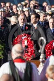 Ed Miliband, as Leader of the Opposition, about to lay a wreath at the Cenotaph. In the foreground, and out of focus, the Bishop of London.
