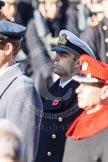Lieutenant Commander Andrew Canale, Royal Navy, Equerry for HM The Queen, during the service by the Bishop of London.