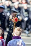 The golden cross with the poppies held by the cross bearer during the service by the Bishop of London.