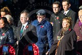 Remembrance Sunday Cenotaph March Past 2013: M23 - Civilians Representing Families.. Press stand opposite the Foreign Office building, Whitehall, London SW1, London, Greater London, United Kingdom, on 10 November 2013 at 12:12, image #2064