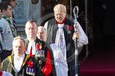 The Serjeant of the Vestry, The Chaplain of the Fleet (The Reverend Scott Brown), the Sub-Dean of Her Majesty's Chapel Royal (the Reverend Prebendary William Scott), and the Dean of HM Chapel Royal, the Bishop of London emerging from the Foreign- and Commonwealth Building.