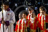 The Cross Bearer, Johan de Silva, followed by the Choir.