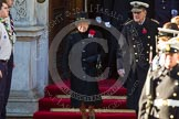 HM The Queen and HRH The Duke of Edinburgh emerging from the Foreign and Commonwealth Building.