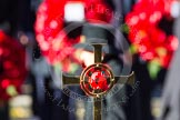 The golden cross with the poppies, held by cross bearer.
