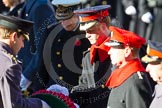 HRH Prince Henry of Wales is given the wreath by Captain Charles Beare.