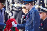 HRH The Duke of Cambridge is given the wreath by Major James Lowther-Pinkerton.