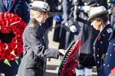 HRH The EPrincess Royal is given the wreath by Commander Anne Sullivan, RN.
