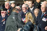 Remembrance Sunday at the Cenotaph in London 2014: Group E4 - Fleet Air Arm Armourers Association. Press stand opposite the Foreign Office building, Whitehall, London SW1, London, Greater London, United Kingdom, on 09 November 2014 at 11:50, image #616