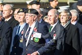 Remembrance Sunday at the Cenotaph in London 2014: Group E4 - Fleet Air Arm Armourers Association. Press stand opposite the Foreign Office building, Whitehall, London SW1, London, Greater London, United Kingdom, on 09 November 2014 at 11:50, image #618