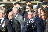 Remembrance Sunday at the Cenotaph in London 2014: Group E4 - Fleet Air Arm Armourers Association. Press stand opposite the Foreign Office building, Whitehall, London SW1, London, Greater London, United Kingdom, on 09 November 2014 at 11:50, image #620