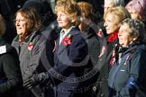 Remembrance Sunday at the Cenotaph in London 2014: Group E24 - Queen Alexandra's Royal Naval Nursing Service. Press stand opposite the Foreign Office building, Whitehall, London SW1, London, Greater London, United Kingdom, on 09 November 2014 at 11:52, image #754
