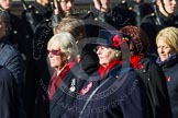 Remembrance Sunday at the Cenotaph in London 2014: Group E24 - Queen Alexandra's Royal Naval Nursing Service. Press stand opposite the Foreign Office building, Whitehall, London SW1, London, Greater London, United Kingdom, on 09 November 2014 at 11:53, image #756
