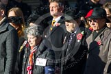 Remembrance Sunday at the Cenotaph in London 2014: Group M4 - Children of the Far East Prisoners of War. Press stand opposite the Foreign Office building, Whitehall, London SW1, London, Greater London, United Kingdom, on 09 November 2014 at 12:15, image #1991