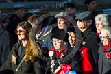 Remembrance Sunday at the Cenotaph in London 2014: Group M23 - Civilians Representing Families. Press stand opposite the Foreign Office building, Whitehall, London SW1, London, Greater London, United Kingdom, on 09 November 2014 at 12:17, image #2149