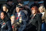 Remembrance Sunday at the Cenotaph in London 2014: Group M23 - Civilians Representing Families. Press stand opposite the Foreign Office building, Whitehall, London SW1, London, Greater London, United Kingdom, on 09 November 2014 at 12:18, image #2154