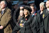 Remembrance Sunday at the Cenotaph in London 2014: Group M23 - Civilians Representing Families. Press stand opposite the Foreign Office building, Whitehall, London SW1, London, Greater London, United Kingdom, on 09 November 2014 at 12:18, image #2156