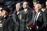 Remembrance Sunday at the Cenotaph in London 2014: Group M23 - Civilians Representing Families. Press stand opposite the Foreign Office building, Whitehall, London SW1, London, Greater London, United Kingdom, on 09 November 2014 at 12:18, image #2157
