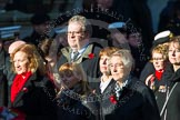 Remembrance Sunday at the Cenotaph in London 2014: Group M23 - Civilians Representing Families. Press stand opposite the Foreign Office building, Whitehall, London SW1, London, Greater London, United Kingdom, on 09 November 2014 at 12:18, image #2160