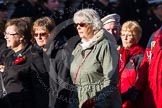 Remembrance Sunday at the Cenotaph in London 2014: Group M23 - Civilians Representing Families. Press stand opposite the Foreign Office building, Whitehall, London SW1, London, Greater London, United Kingdom, on 09 November 2014 at 12:18, image #2165