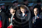 Remembrance Sunday at the Cenotaph in London 2014: Group M23 - Civilians Representing Families. Press stand opposite the Foreign Office building, Whitehall, London SW1, London, Greater London, United Kingdom, on 09 November 2014 at 12:18, image #2167