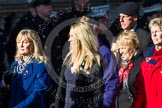 Remembrance Sunday at the Cenotaph in London 2014: Group M23 - Civilians Representing Families. Press stand opposite the Foreign Office building, Whitehall, London SW1, London, Greater London, United Kingdom, on 09 November 2014 at 12:18, image #2172