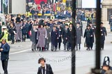 Remembrance Sunday at the Cenotaph in London 2014: The first column of veterans arrives at Whitehall. All the veterans gather at Horse Guards Parade before the event.. Press stand opposite the Foreign Office building, Whitehall, London SW1, London, Greater London, United Kingdom, on 09 November 2014 at 10:15, image #26