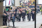 Remembrance Sunday at the Cenotaph in London 2014: The first column of veterans arrives at Whitehall. All the veterans gather at Horse Guards Parade before the event.. Press stand opposite the Foreign Office building, Whitehall, London SW1, London, Greater London, United Kingdom, on 09 November 2014 at 10:15, image #27