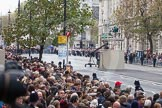 Remembrance Sunday at the Cenotaph in London 2014: The first band, the Band of the Royal Marines, arrives at the western side of Whitehall.. Press stand opposite the Foreign Office building, Whitehall, London SW1, London, Greater London, United Kingdom, on 09 November 2014 at 10:16, image #28