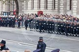 Remembrance Sunday at the Cenotaph in London 2014: The Royal Navy detachment is followed by the Royal Marines detachment, they will line the northern side of Whitehall together. Press stand opposite the Foreign Office building, Whitehall, London SW1, London, Greater London, United Kingdom, on 09 November 2014 at 10:17, image #34