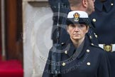 Remembrance Sunday at the Cenotaph in London 2014: A female member of the Royal Navy detachment at the door of the Foreign- and Commonwealth Office. Press stand opposite the Foreign Office building, Whitehall, London SW1, London, Greater London, United Kingdom, on 09 November 2014 at 10:19, image #41