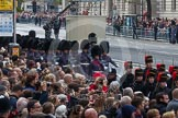 Remembrance Sunday at the Cenotaph in London 2014: The detachment of the Household Division Welsh Guards arrives at Whitehall. In front of them the King's Troop Royal Horse Artillery. Press stand opposite the Foreign Office building, Whitehall, London SW1, London, Greater London, United Kingdom, on 09 November 2014 at 10:25, image #63
