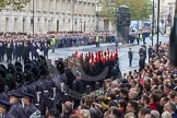 Remembrance Sunday at the Cenotaph in London 2014: The line-up of Welsh Guards, Royal Horse Artillery, and Household Cavalry on the southern side of Whitehall. Press stand opposite the Foreign Office building, Whitehall, London SW1, London, Greater London, United Kingdom, on 09 November 2014 at 10:26, image #66