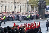 Remembrance Sunday at the Cenotaph in London 2014: The first long column of veterans waiting for the start of the March Past. Press stand opposite the Foreign Office building, Whitehall, London SW1, London, Greater London, United Kingdom, on 09 November 2014 at 10:29, image #71