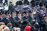 Remembrance Sunday at the Cenotaph in London 2014: A detachment of the Civil Services (Fire Brigade?) arriving at Whitehall. Press stand opposite the Foreign Office building, Whitehall, London SW1, London, Greater London, United Kingdom, on 09 November 2014 at 10:31, image #74