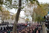 Remembrance Sunday at the Cenotaph in London 2014: Whitehall before the event, lines with large numbers of spectators and over ten thousand veterans waiting for the March Past. Press stand opposite the Foreign Office building, Whitehall, London SW1, London, Greater London, United Kingdom, on 09 November 2014 at 10:53, image #93