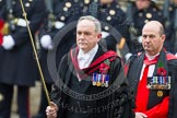 Remembrance Sunday at the Cenotaph in London 2014: The Serjeant of the Vestry, David Baldwin, followed by the Chaplain General to HM Land Forces, Reverend Dr David George Coulter. Press stand opposite the Foreign Office building, Whitehall, London SW1, London, Greater London, United Kingdom, on 09 November 2014 at 10:54, image #110