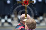 Remembrance Sunday at the Cenotaph in London 2014: The golden cross with the red poppies, carried by the Cross Bearer. Press stand opposite the Foreign Office building, Whitehall, London SW1, London, Greater London, United Kingdom, on 09 November 2014 at 10:54, image #118
