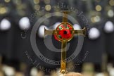 Remembrance Sunday at the Cenotaph in London 2014: The golden cross with the red poppies. Press stand opposite the Foreign Office building, Whitehall, London SW1, London, Greater London, United Kingdom, on 09 November 2014 at 10:54, image #119
