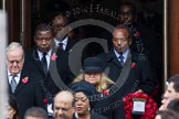 Remembrance Sunday at the Cenotaph in London 2014: The High Commissioners emerging from the door of the Foreign- and Commonwealth Office. Press stand opposite the Foreign Office building, Whitehall, London SW1, London, Greater London, United Kingdom, on 09 November 2014 at 10:56, image #133