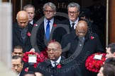 Remembrance Sunday at the Cenotaph in London 2014: The High Commissioners emerging from the door of the Foreign- and Commonwealth Office. Press stand opposite the Foreign Office building, Whitehall, London SW1, London, Greater London, United Kingdom, on 09 November 2014 at 10:56, image #136