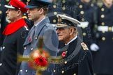 Remembrance Sunday at the Cenotaph in London 2014: HRH The Duke of Edinburgh, HRH The Duke of Cambridge, and HRH The Earl of Wessex, with the golden cross, out of focus, in front. Press stand opposite the Foreign Office building, Whitehall, London SW1, London, Greater London, United Kingdom, on 09 November 2014 at 10:59, image #149