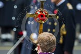 Remembrance Sunday at the Cenotaph in London 2014: The golden cross with the red poppies, carried by the Cross Bearer, in fron of members of the Royal Family. Press stand opposite the Foreign Office building, Whitehall, London SW1, London, Greater London, United Kingdom, on 09 November 2014 at 11:03, image #183