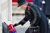 Remembrance Sunday at the Cenotaph in London 2014: HM The Queen laying her wreath at the Cenotaph. Press stand opposite the Foreign Office building, Whitehall, London SW1, London, Greater London, United Kingdom, on 09 November 2014 at 11:03, image #188