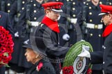 Remembrance Sunday at the Cenotaph in London 2014: Major Richard Morgan, equerry to HRH The Earl of Wessex, handing over the wreath. Press stand opposite the Foreign Office building, Whitehall, London SW1, London, Greater London, United Kingdom, on 09 November 2014 at 11:06, image #210