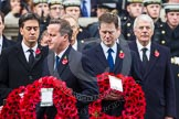 Remembrance Sunday at the Cenotaph in London 2014: Prime Minister David Cameron walking towards the Cenotaph with his wreath. Behind him Ed Milliband and Nick Clegg,. Press stand opposite the Foreign Office building, Whitehall, London SW1, London, Greater London, United Kingdom, on 09 November 2014 at 11:06, image #216