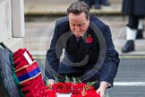 Remembrance Sunday at the Cenotaph in London 2014: The Prime Minister, the Rt Hon David Cameron, laying a wreath at the Cenotaph. Press stand opposite the Foreign Office building, Whitehall, London SW1, London, Greater London, United Kingdom, on 09 November 2014 at 11:07, image #219
