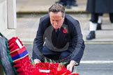 Remembrance Sunday at the Cenotaph in London 2014: The Prime Minister, the Rt Hon David Cameron, laying a wreath at the Cenotaph. Press stand opposite the Foreign Office building, Whitehall, London SW1, London, Greater London, United Kingdom, on 09 November 2014 at 11:07, image #220