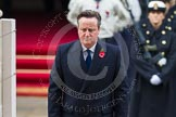 Remembrance Sunday at the Cenotaph in London 2014: Prime Minister David Cameron standing at the Cenotaph after having laid his wreath. Press stand opposite the Foreign Office building, Whitehall, London SW1, London, Greater London, United Kingdom, on 09 November 2014 at 11:07, image #221